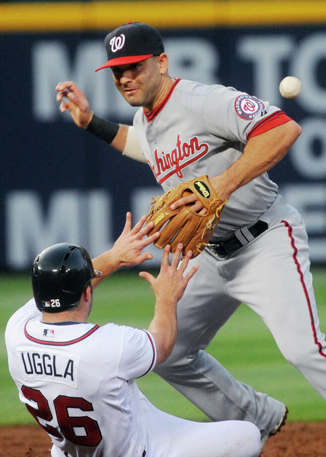 Washington Nationals second baseman Danny Espinosa forces out Atlanta Braves Dan Uggla  but can't keep hold of the ball to turn a double play during the third inning of an MLB baseball game, Monday, April 29, 2013, in Atlanta. (AP Photo/John Amis) Photo: John Amis