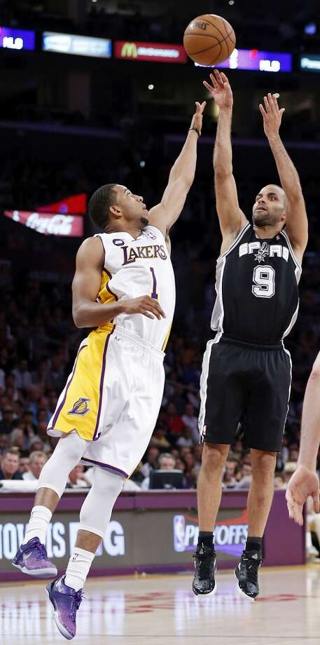 The Spurs' Tony Parker shoots over the Lakers' Darius Morris. Parker scored 23 points to lead the Spurs to a 103-82 victory in Game 4 that completed the Spurs' first-round sweep of the Lakers.