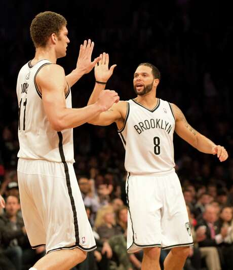 Brooklyn Nets Deron Williams (8) and Brook Lopez (11) celebrate against the Chicago Bulls during game five of their first round NBA playoff game April 29, 2013 at the Barclay Center in New York. AFP PHOTO/Don EmmertDON EMMERT/AFP/Getty Images Photo: DON EMMERT, Staff / AFP