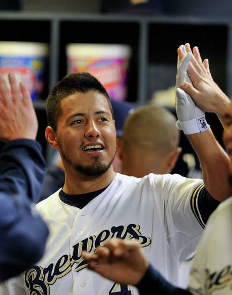 Pitcher  Yovani Gallardo is congratulated after hitting one of the Brewers' five home runs in their 10-4 win over the Pirates.  Gallardo earned the victory, allowing two runs and three hits in seven innings. Photo: Jim Prisching, FRE / FR59933 AP