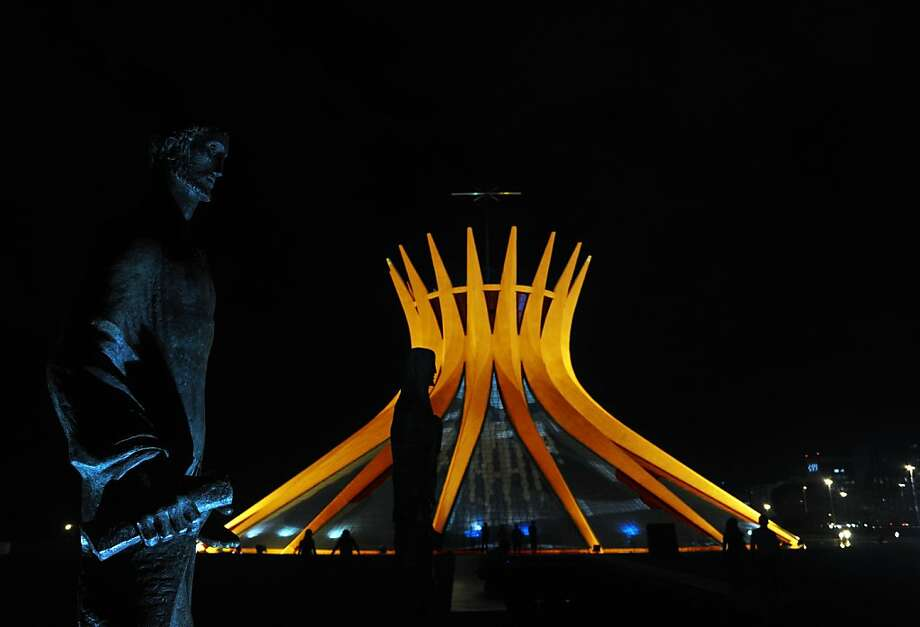 Brasilia's Metropolitan Cathedral is illuminated in orange in honor of Queen Beatrix of the Netherlands, who will abdicate next April 30 in favour of Prince Willem-Alexander, on April 29, 2013 . AFP PHOTO / Evaristo SAEVARISTO SA/AFP/Getty Images Photo: Evaristo Sa, AFP/Getty Images