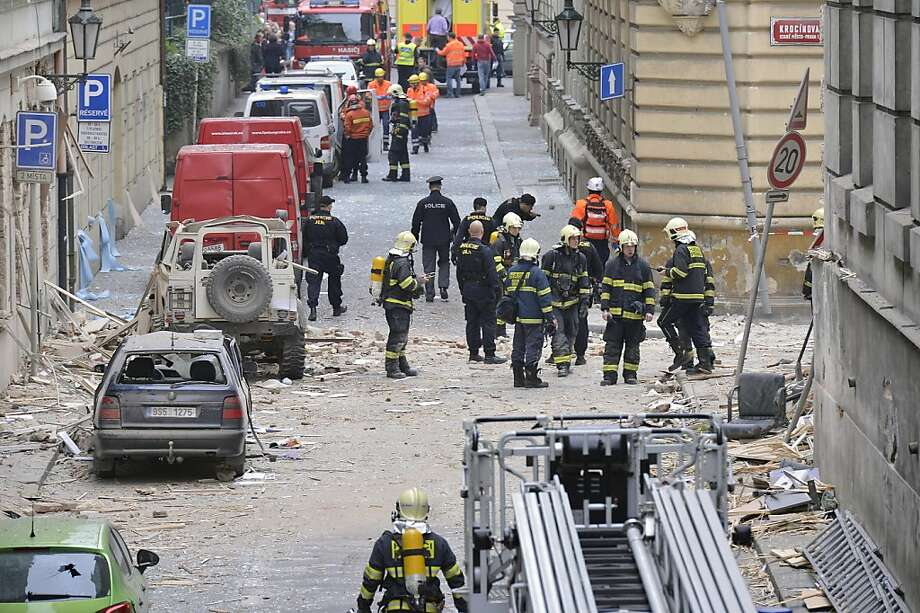 Firefighters and rescue workers work at the scene of a strong blast in a building in the center of Prague, Czech Republic, in the morning on Monday, April 29, 2013.  A powerful explosion badly damaged an office building in the center of the Czech capital Monday, injuring up to 40 people. Authorities believe people may still be buried in the rubble.  (AP Photo/CTK, Michal Dolezal) Photo: Michal Dolezal, Associated Press