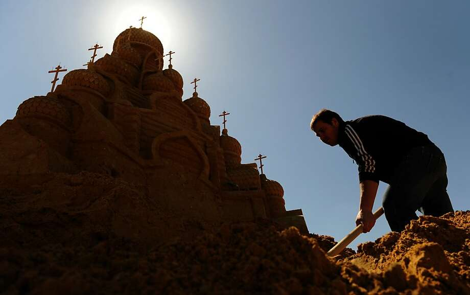 A sculptor works on the sand sculpture of an Orthodox cathedral during Sand Sculptures Festival in Moscow on April 29, 2013. AFP PHOTO / ANDREY SMIRNOVANDREY SMIRNOV/AFP/Getty Images Photo: Andrey Smirnov, AFP/Getty Images