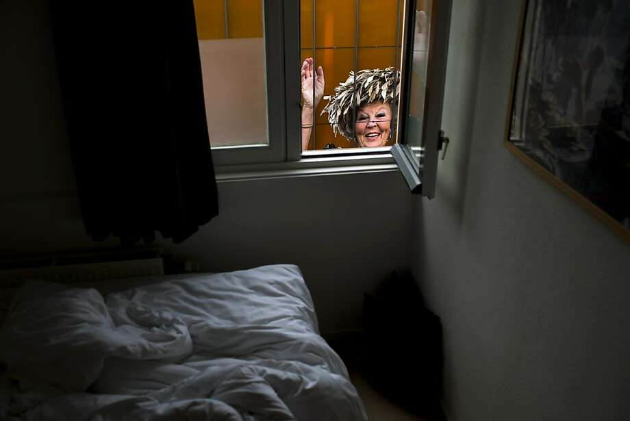 An image of Dutch Queen Beatrix Is photographed from the window of an empty room in downtown Amsterdam, Netherlands Monday, April 29, 2013. Queen Beatrix has announced she will relinquish the crown on April 30, 2013, after 33 years of reign, leaving the monarchy to her son Crown Prince Willem Alexander. (AP Photo/Emilio Morenatti) Photo: Emilio Morenatti, Associated Press
