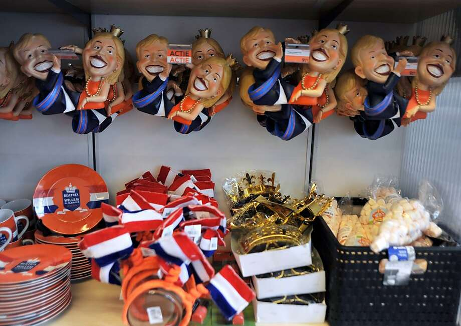 A picture taken on April 19,2013 shows items on sale in a shop in The Hague, some days ahead of the enthronement ceremony of Dutch Crown Prince Willem-Alexander. The prince will succeed, on April 29, 2013, to his mother Queen Beatrix who will abdicate after 33 years on the throne. The orange color symbolizes the House of Orange-Nassau. AFP PHOTO NICOLAS DELAUNAYNICOLAS DELAUNAY/AFP/Getty Images Photo: Nicolas Delaunay, AFP/Getty Images