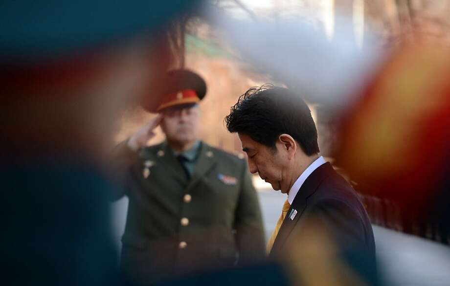 Japan's Prime Minister Shinzo Abe lays a wreath at the Tomb of the Unknown Soldier in Moscow on April 29, 2013. Japanese Prime Minister Shinzo Abe was set to meet Russian President Vladimir Putin in Moscow on April 29 during the first top-level visit in a decade as the two countries seek to revive ties soured by a festering territorial dispute. AFP PHOTO/KIRILL KUDRYAVTSEVKIRILL KUDRYAVTSEV/AFP/Getty Images Photo: Kirill Kudryavtsev, AFP/Getty Images