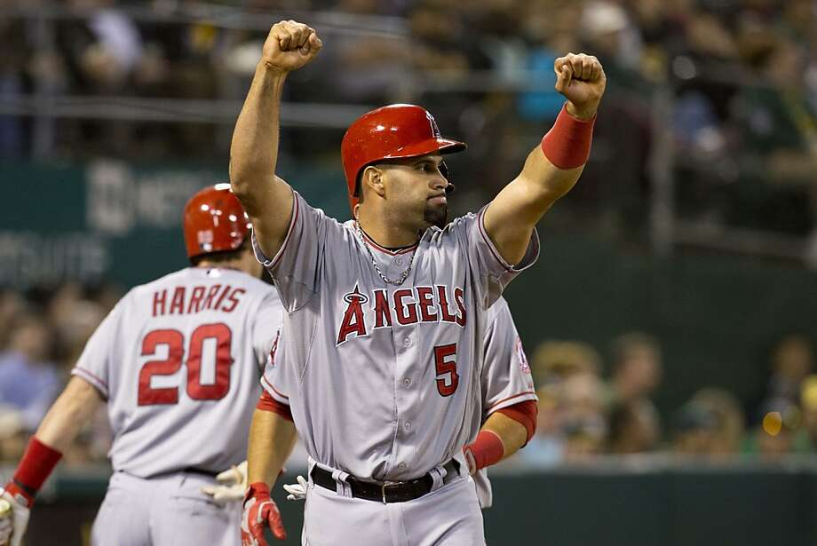 OAKLAND, CA - APRIL 29:  Albert Pujols #5 of the Los Angeles Angels of Anaheim celebrates after scoring on a two RBI double from Mark Trumbo #44 of the Los Angeles Angels of Anaheim (not pictured) during the fifth inning against the Oakland Athletics at O.co Coliseum on April 29, 2013 in Oakland, California. (Photo by Jason O. Watson/Getty Images) Photo: Jason O. Watson, Getty Images
