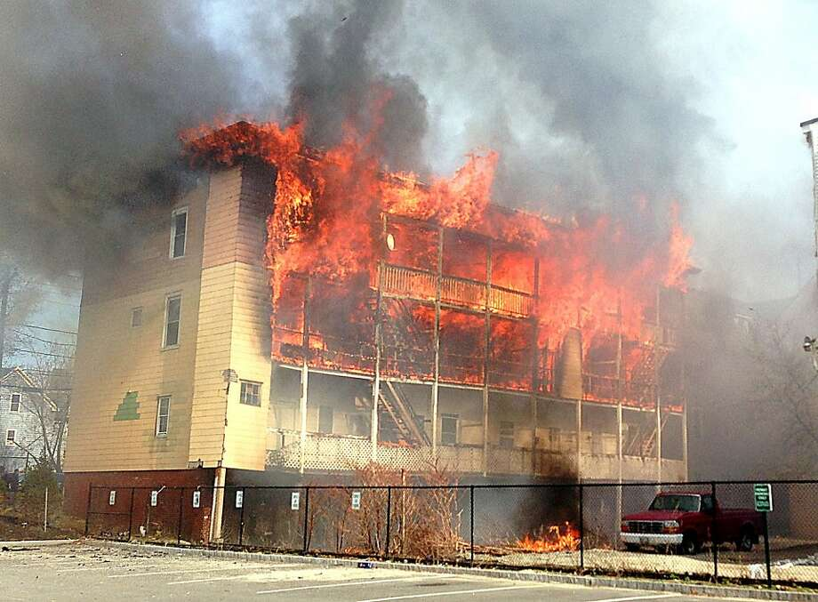 Fire engulfs an apartment building in Lewiston, Maine. Two other apartment buildings in the complex also burned, displacing a total of at least 75 people. The cause of the blaze was not immediately known. Photo: Christopher Williams, Associated Press