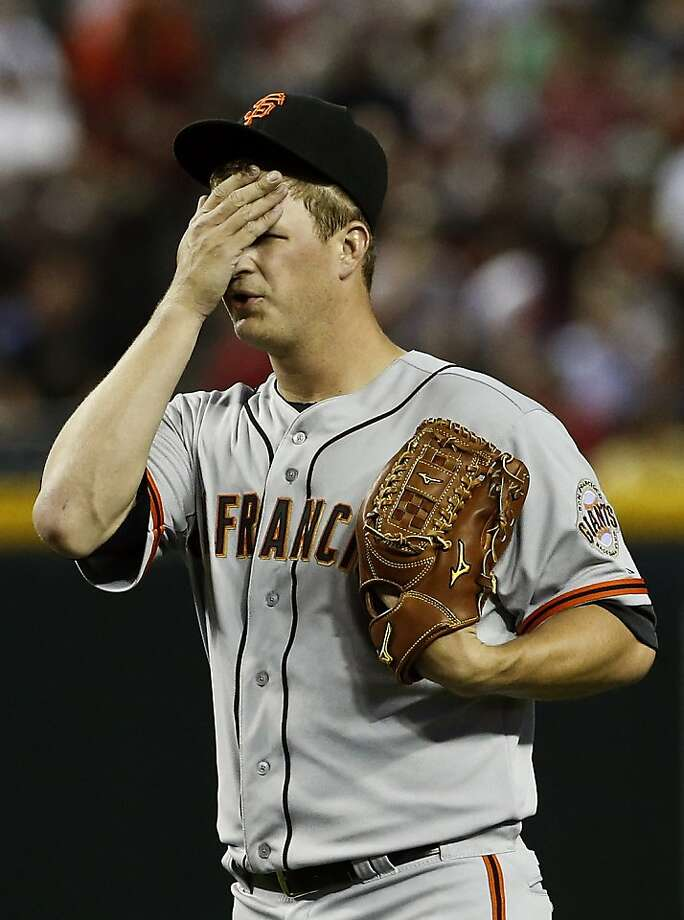 San Francisco Giants' Matt Cain wipes sweat from his forehead during the second inning of a baseball game against the Arizona Diamondbacks on Monday, April 29, 2013, in Phoenix. (AP Photo/Ross D. Franklin) Photo: Ross D. Franklin, Associated Press