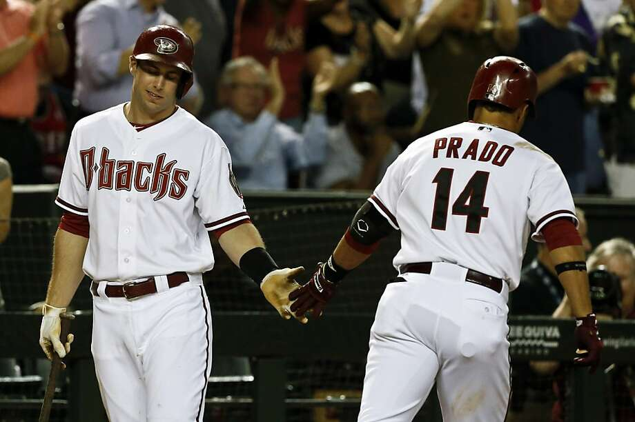 Arizona Diamondbacks' Martin Prado (14) celebrates his home run with teammate Paul Goldschmidt during the fourth inning of a baseball game against the San Francisco Giants on Monday, April 29, 2013, in Phoenix. (AP Photo/Ross D. Franklin) Photo: Ross D. Franklin, Associated Press