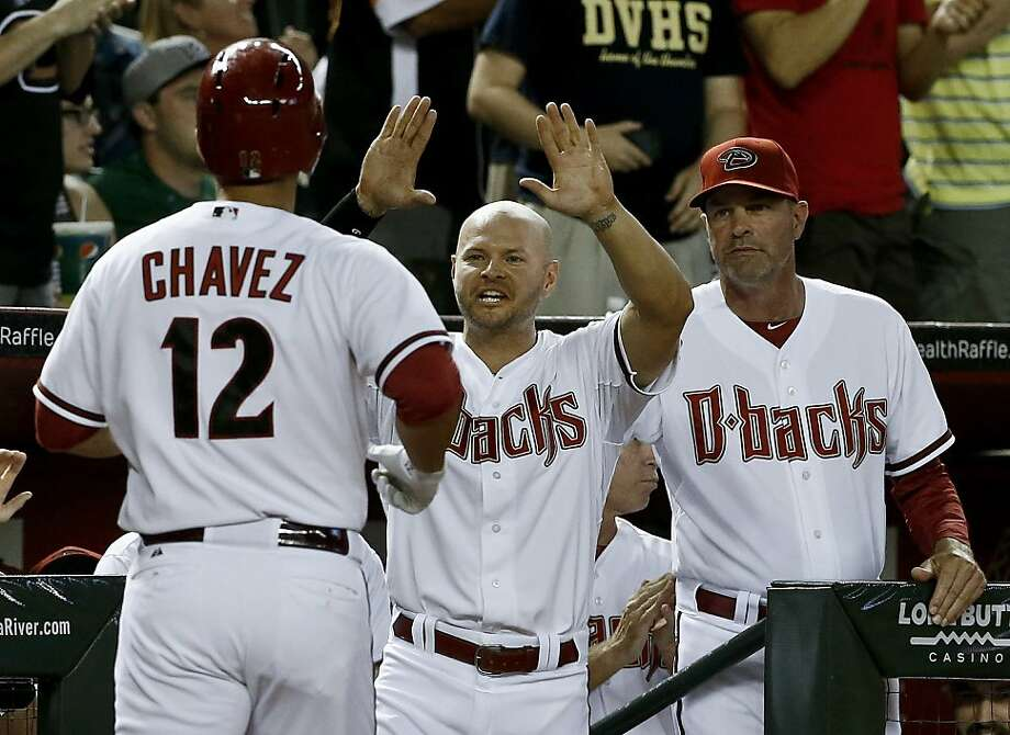 Arizona Diamondbacks' Eric Chavez (12) celebrates his home run with teammate Cody Ross and manager Kirk Gibson, right, during the fourth inning of a baseball game against the San Francisco Giants on Monday, April 29, 2013, in Phoenix. (AP Photo/Ross D. Franklin) Photo: Ross D. Franklin, Associated Press