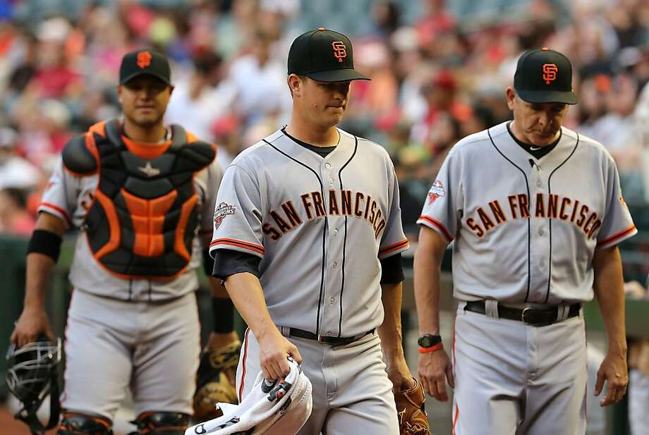 PHOENIX, AZ - APRIL 29:  Starting pticher Matt Cain #18 (C) of the San Francisco Giants walks to the dugout before the MLB game against the Arizona Diamondbacks at Chase Field on April 29, 2013 in Phoenix, Arizona.  (Photo by Christian Petersen/Getty Images) Photo: Christian Petersen, Getty Images