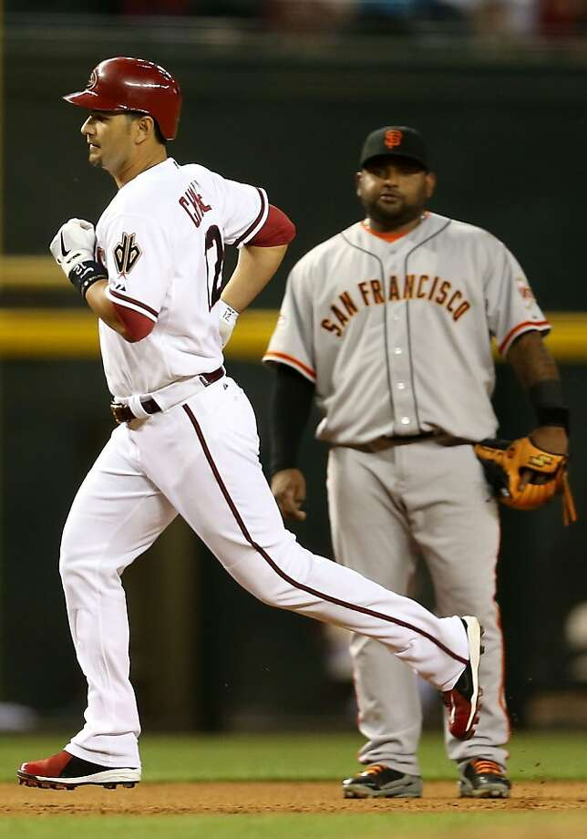 PHOENIX, AZ - APRIL 29:  Eric Chavez #12 of the Arizona Diamondbacks rounds the bases ahead of infielder Pablo Sandoval #48 of the San Francisco Giants after Chavez hit solo home run during the fourth inning of the MLB game at Chase Field on April 29, 2013 in Phoenix, Arizona.  (Photo by Christian Petersen/Getty Images) Photo: Christian Petersen, Getty Images