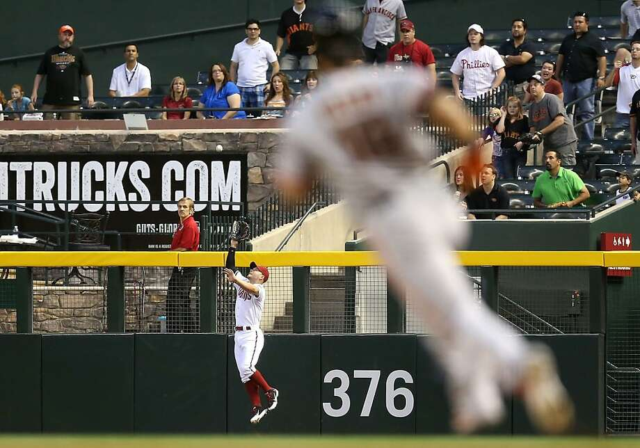 PHOENIX, AZ - APRIL 29:  Outfielder Cody Ross #7 of the Arizona Diamondbacks makes a leaping catch on a fly ball hit by Angel Pagan #16 of the San Francisco Giants during the second inning of the MLB game at Chase Field on April 29, 2013 in Phoenix, Arizona.  (Photo by Christian Petersen/Getty Images) Photo: Christian Petersen, Getty Images