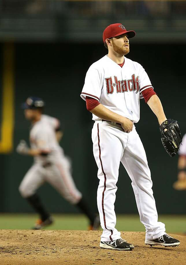 PHOENIX, AZ - APRIL 29:  Starting pitcher Ian Kennedy #31 of the Arizona Diamondbacks reacts after giving up a solo home run to Brandon Belt #9 of the San Francisco Giants during the second inning of the MLB game at Chase Field on April 29, 2013 in Phoenix, Arizona.  (Photo by Christian Petersen/Getty Images) Photo: Christian Petersen, Getty Images