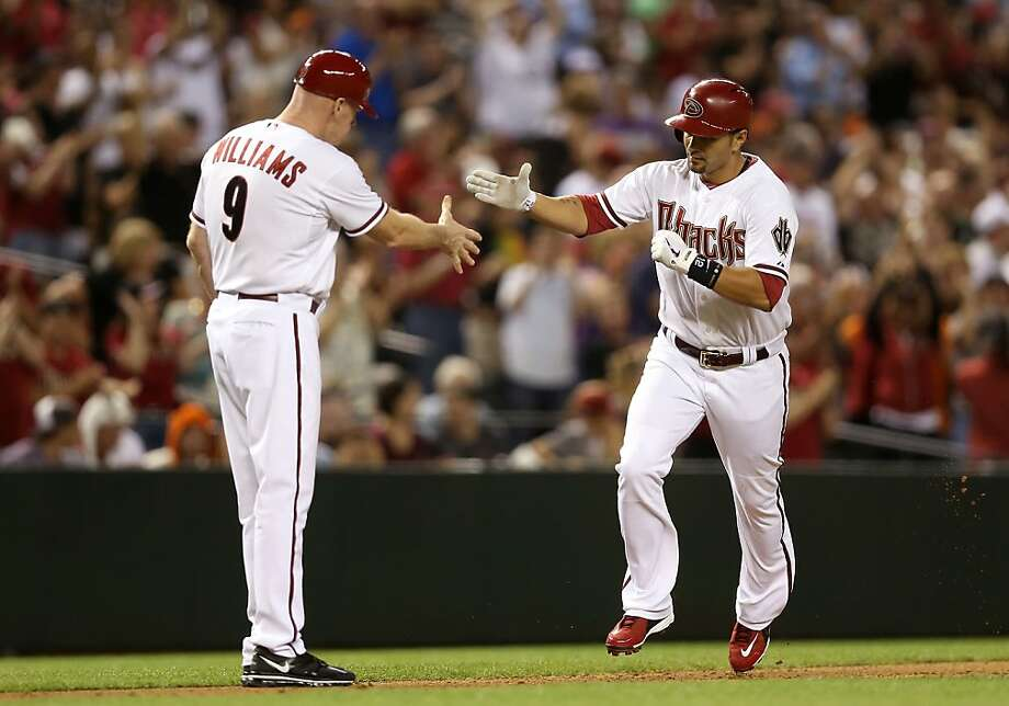 PHOENIX, AZ - APRIL 29:  Eric Chavez #12 of the Arizona Diamondbacks high fives third base coach Matt Williams after hitting a solo home run against the San Francisco Giants during the fourth inning of the MLB game at Chase Field on April 29, 2013 in Phoenix, Arizona.  (Photo by Christian Petersen/Getty Images) Photo: Christian Petersen, Getty Images