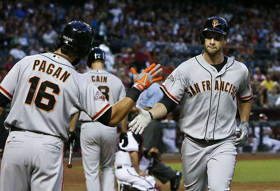 San Francisco Giants' Brandon Belt, right, shakes hands with teammate Angel Pagan (16) after hitting a home run against the Arizona Diamondbacks during the second inning of a baseball game, on Monday, April 29, 2013, in Phoenix. (AP Photo/Ross D. Franklin) Photo: Ross D. Franklin, Associated Press