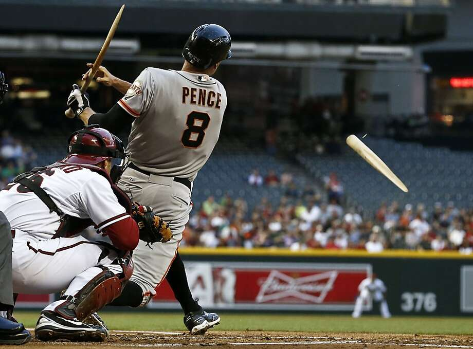San Francisco Giants' Hunter Pence (8) breaks his bat while hitting a sacrifice fly as Arizona Diamondbacks' Miguel Montero watches during the first inning of a baseball game, on Monday, April 29, 2013, in Phoenix. (AP Photo/Ross D. Franklin) Photo: Ross D. Franklin, Associated Press