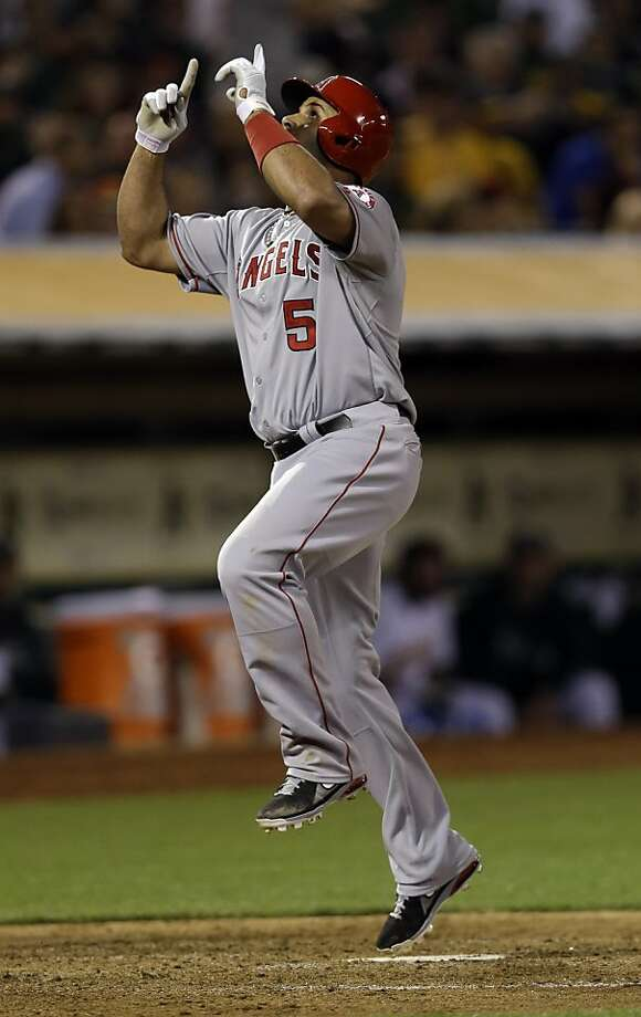 Los Angeles Angels' Albert Pujols (5) celebrate his solo home run against the Oakland Athletics during the seventh inning of a baseball game on Monday, April 29, 2013 in Oakland. Calif. (AP Photo/Marcio Jose Sanchez) Photo: Marcio Jose Sanchez, Associated Press