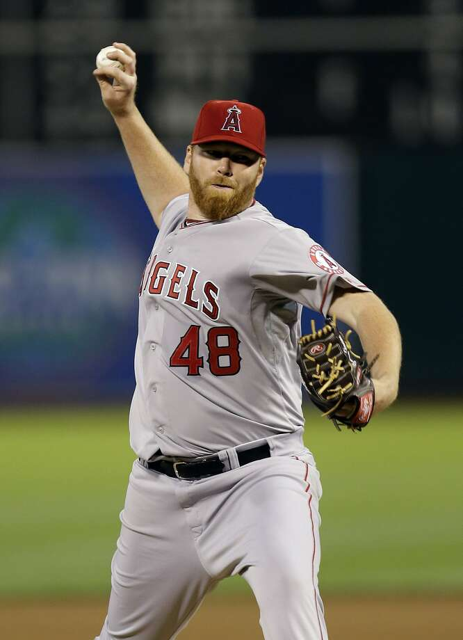 Los Angeles Angels starting pitcher Tommy Hanson throws to the Oakland Athletics during the fourth inning of a baseball game on Monday, April 29, 2013 in Oakland. Calif. (AP Photo/Marcio Jose Sanchez) Photo: Marcio Jose Sanchez, Associated Press