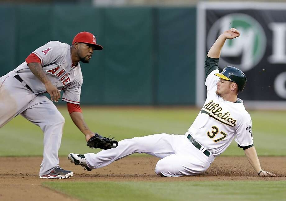 Oakland Athletics' Brandon Moss (37) steals second base as  Los Angeles Angels second baseman Howie Kendrick  awaits the throw during the second inning of a baseball game on Monday, April 29, 2013 in Oakland. Calif. (AP Photo/Marcio Jose Sanchez) Photo: Marcio Jose Sanchez, Associated Press