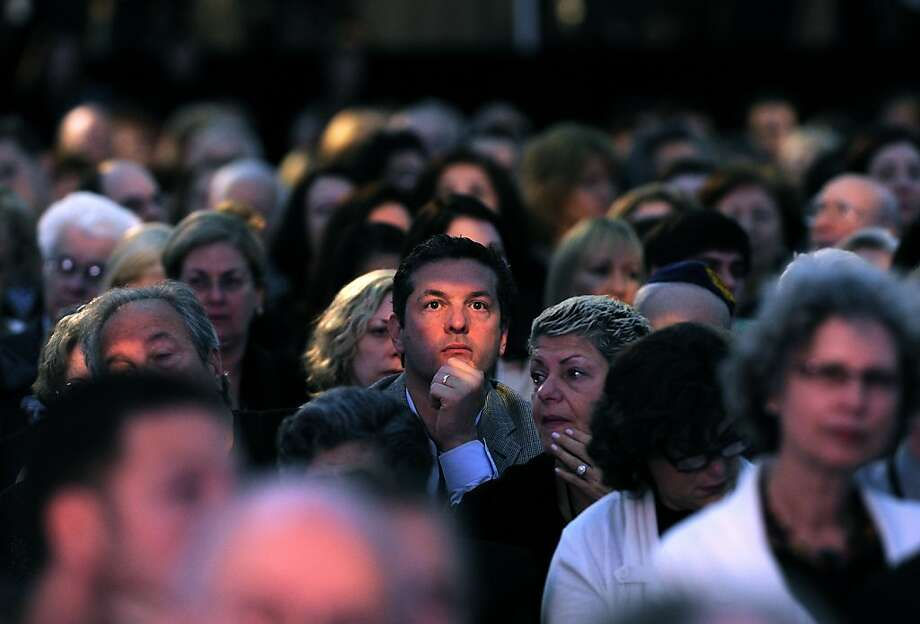 Attendees listen to former US president Bill Clinton speak during a ceremony to celebrate the Holocaust Memorial Museum's 20th anniversary in Washington on April 29, 2013.    AFP PHOTO/Jewel SamadJEWEL SAMAD/AFP/Getty Images Photo: Jewel Samad, AFP/Getty Images