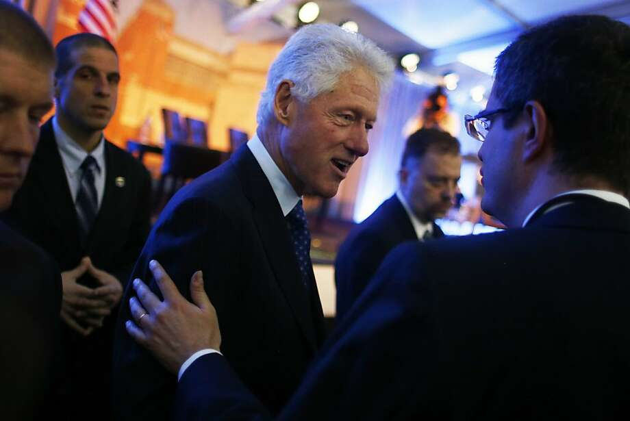 Former President Bill Clinton greets audience members after he spoke at the 20th anniversary of the United States Holocaust Memorial Museum in Washington, Monday, April 29, 2013. (AP Photo/Charles Dharapak) Photo: Charles Dharapak, Associated Press