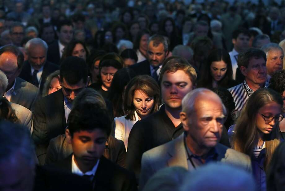 Audience members comprising of Holocaust survivors, veterans, and family members stand during a moment of silence in a tent sent up across from the museum for the 20th anniversary of the United States Holocaust Memorial Museum in Washington, Monday, April 29, 2013. (AP Photo/Charles Dharapak) Photo: Charles Dharapak, Associated Press