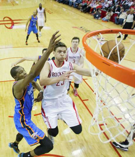 The game's top scorers are isolated as Rockets forward Chandler Parsons (27 points) drives to the basket past Thunder forward Kevin Durant (38). Durant won the scoring battle Monday, Parsons the war. Photo: Smiley N. Pool, Staff / © 2013  Houston Chronicle