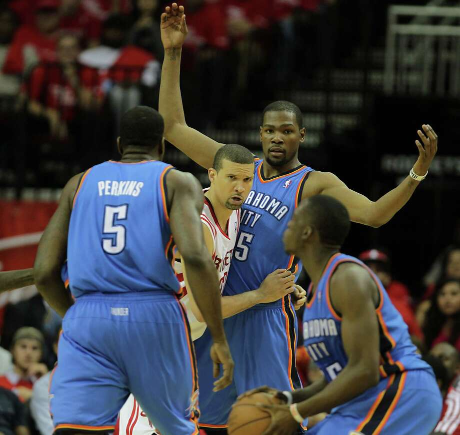 The Thunder's Kevin Durant, second from right, and Reggie Jackson, right, couldn't solve Francisco Garcia, second from left, and the Rockets on Monday. Photo: James Nielsen, Staff / © 2013  Houston Chronicle