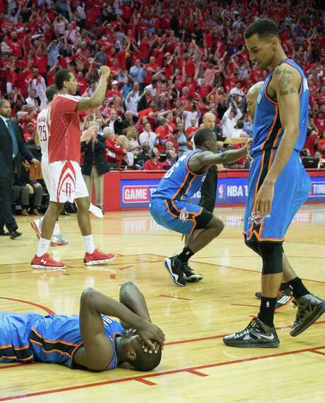 After the Rockets felt the agony of two close losses in Games 2 and 3, it was the Thunder's turn to suffer on Monday night as forward Serge Ibaka, left, and guard Reggie Jackson, center, missed last-second shots that allowed the Rockets to hang on for the win. Photo: Smiley N. Pool, Staff / © 2013  Houston Chronicle