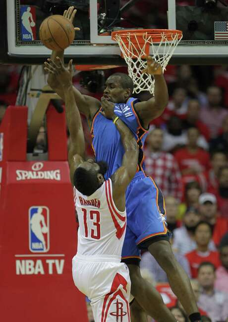 Rockets guard James Harden (13), who was only 4-of-12 from the field on Monday, encounters a surge of Thunder, in this case Oklahoma City forward Serge Ibaka. Photo: James Nielsen, Staff / © 2013  Houston Chronicle