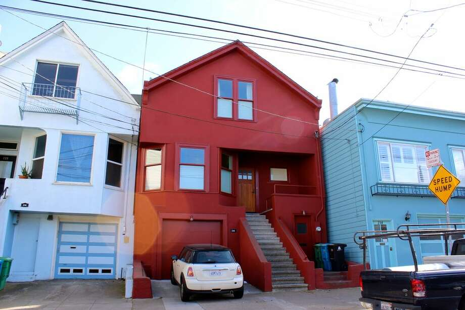 1.  The International Orange House -   Not at first so odd, though the color is a bit hauntingly familiar... because it's the same paint hue as used on the Golden Gate Bridge: International Orange. Photo via Alexandra Kenin, Urban Hiker SF