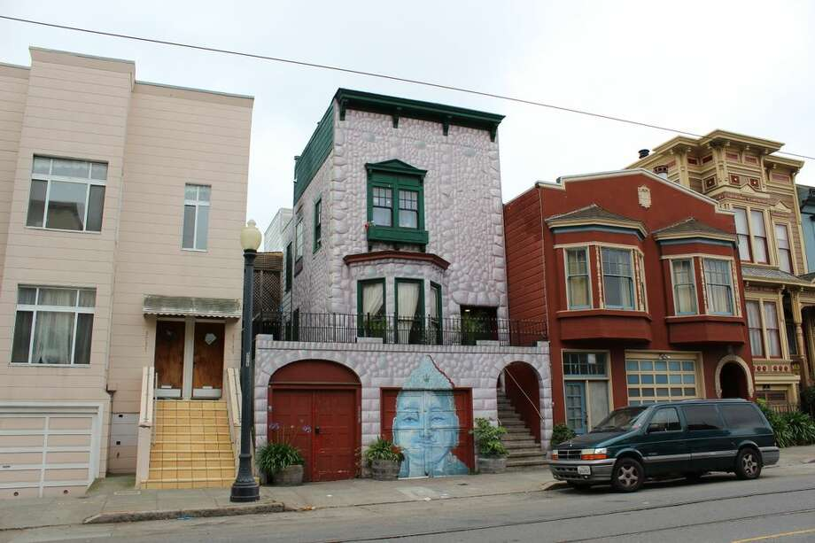 5. The Buddha House - In addition to the Buddha on the garage door, 100% of the 'stones' are painted onto the house. Neighborhood: Castro (17th between Church and Sanchez Streets). Photo via Alexandra Kenin, Urban Hiker SF