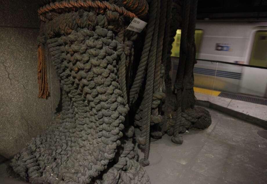 "A macrame sculpture titled ""Legs"" by Barbara Shawcroft hangs at the east end of the Embarcadero BART station on Friday, April 26, 2013 in San Francisco, Calif."