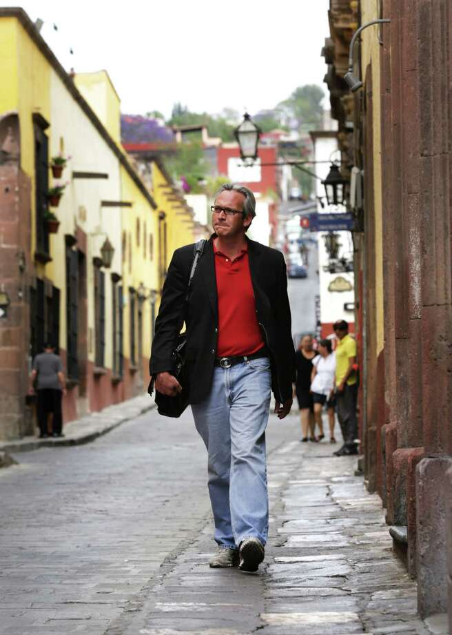 Former San Angelo Mayor Joseph Lown walks down a street in the Centro district of San Miguel de Allende, Mexico, where he sells real estate. (San Antonio Express-News) Photo: BOB OWEN, San Antonio Express-News / © 2012 San Antonio Express-News