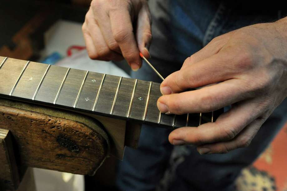 Steven Kovacik dresses fret ends on a custom built Kovacik D-28 style guitar as he works in his shop on Thursday, March 28, 2013 in Scotia, N.Y.  (Lori Van Buren / Times Union) Photo: Lori Van Buren