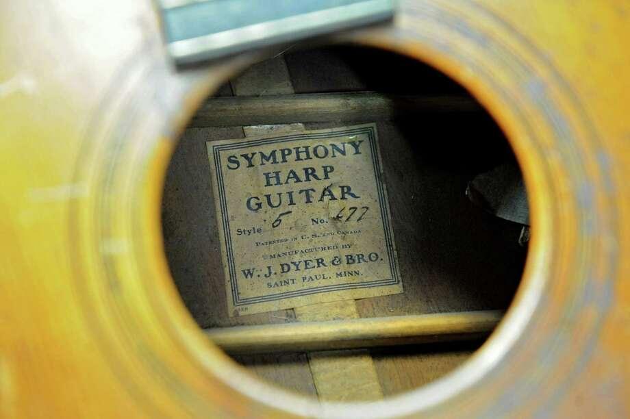 A W. J. Dyer and Bro. Symphony Harp Guitar in Steven Kovacik's basement shop on Thursday, March 28, 2013 in Scotia, N.Y.  (Lori Van Buren / Times Union) Photo: Lori Van Buren