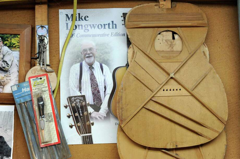 Poster of friend Mike Longworth and a guitar top in Steven Kovacik's basement shop on Thursday, March 28, 2013 in Scotia, N.Y.  (Lori Van Buren / Times Union) Photo: Lori Van Buren