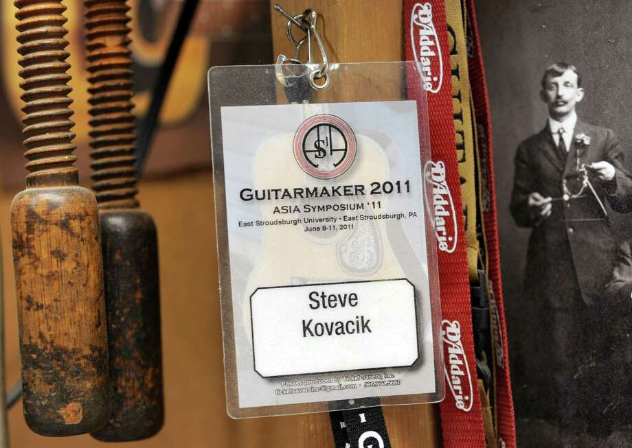 Steven Kovacik's name badge for the 2011 ASIA (Association of Stringed Instrument Artisans) Symposium hangs on a nail in his basement shop on Thursday, March 28, 2013 in Scotia, N.Y. Steven is a board member of ASIA. (Lori Van Buren / Times Union) Photo: Lori Van Buren