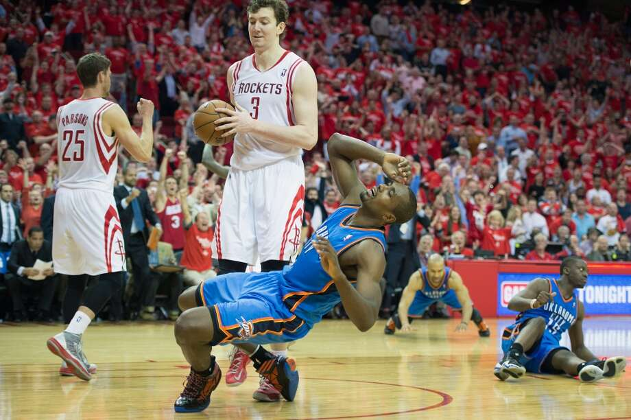 Thunder power forward Serge Ibaka collapses to the floor after his tip attempt on a miss by Reggie Jackson, right, missed at the buzzer. Photo: Smiley N. Pool, Houston Chronicle