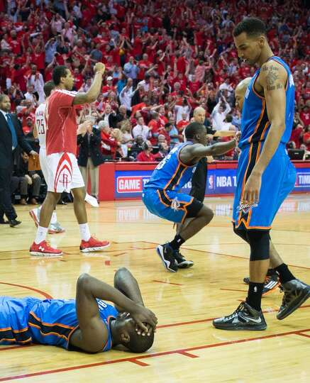 Thunder players react after Serge Ibaka's game-tying attempt at a basket rimmed out.