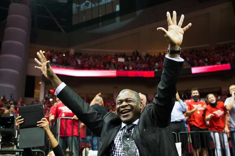 Rockets analyst and former player Calvin Murphy celebrates after the win against the Thunder.