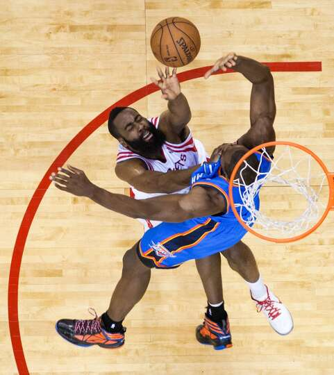 Rockets guard James Harden shoots over Serge Ibaka.
