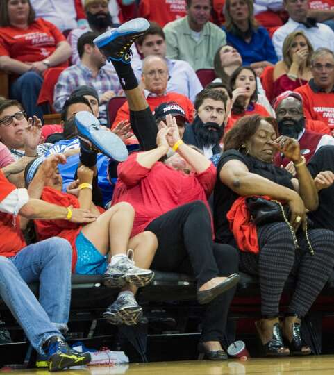 Thunder forward Kevin Durant winds up in the expensive seats at Toyota Center afterc hasing a loose