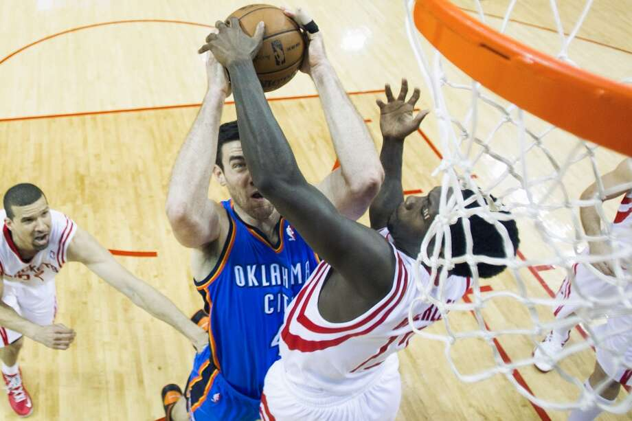 Rockets point guard Patrick Beverley, right, makes a size-defying block on Thunder forward Nick Collison during the second half. Photo: Smiley N. Pool, Houston Chronicle