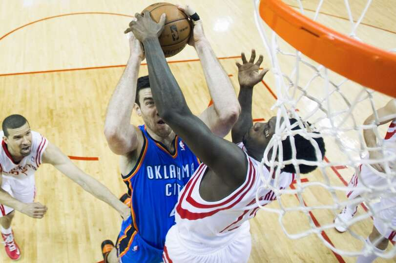 Rockets point guard Patrick Beverley, right, makes a size-defying block on Thunder forward Nick Coll