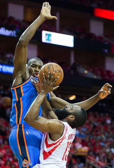 Rockets shooting guard James Harden is fouled by Thunder forward Serge Ibaka.