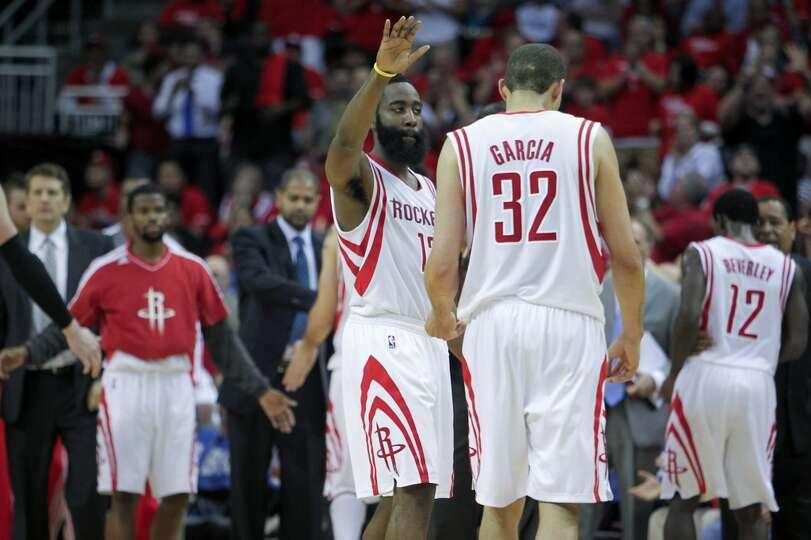 Rockets guard James Harden gives teammate Francisco Garcia a hand.