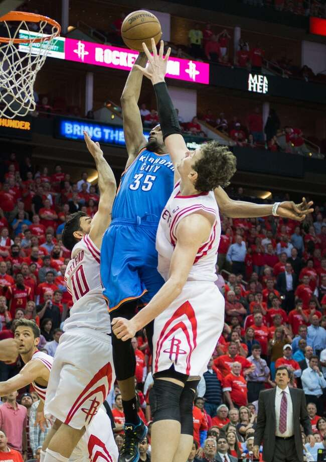 Thunder forward Kevin Durant goes up for a dunk the past Rockets guard Carlos Delfino (10) and center Omer Asik (3) with 1:13 left. Photo: Smiley N. Pool, Houston Chronicle